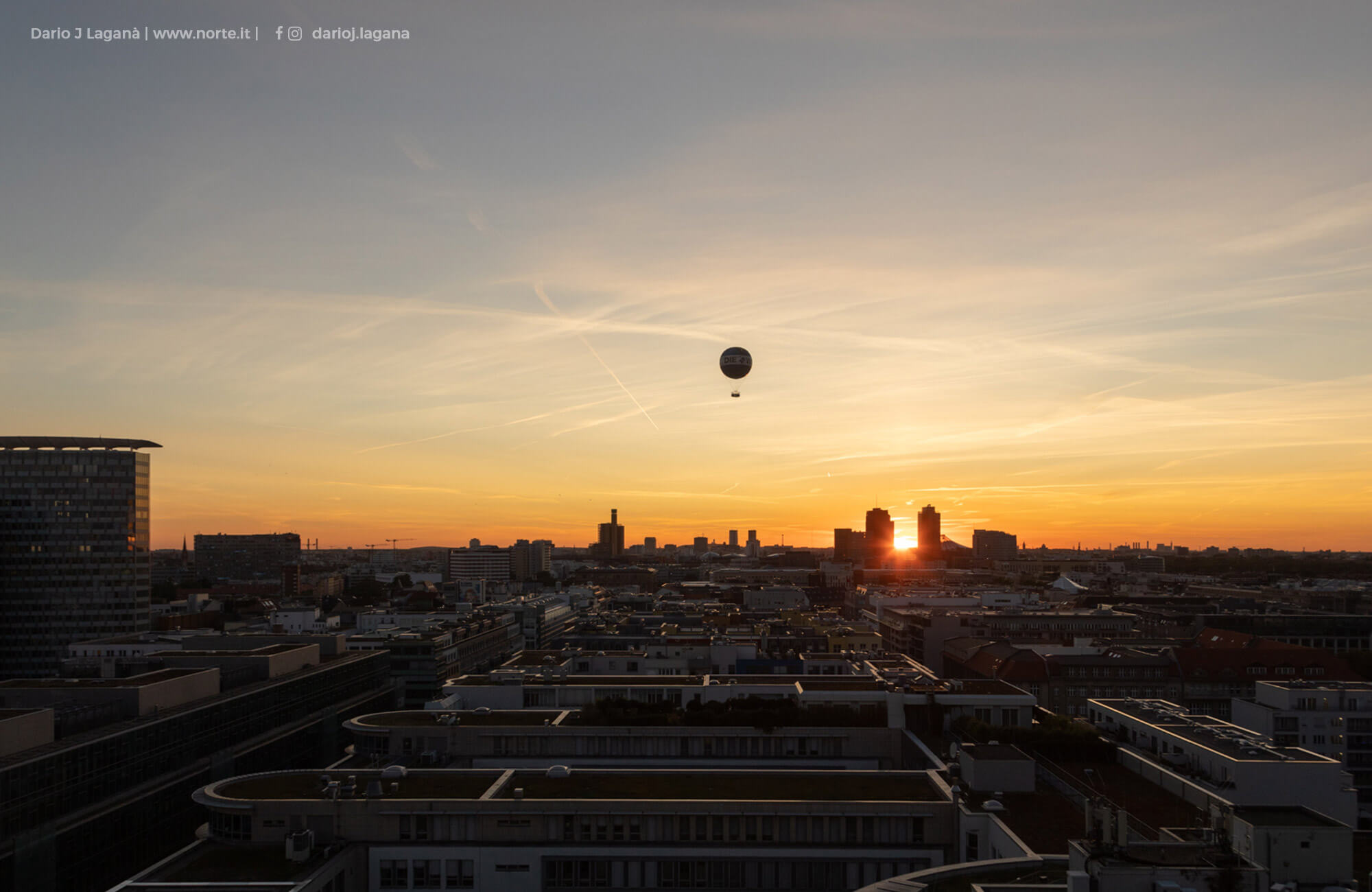 View from the REM roof terrace with hot air balloon before sunset