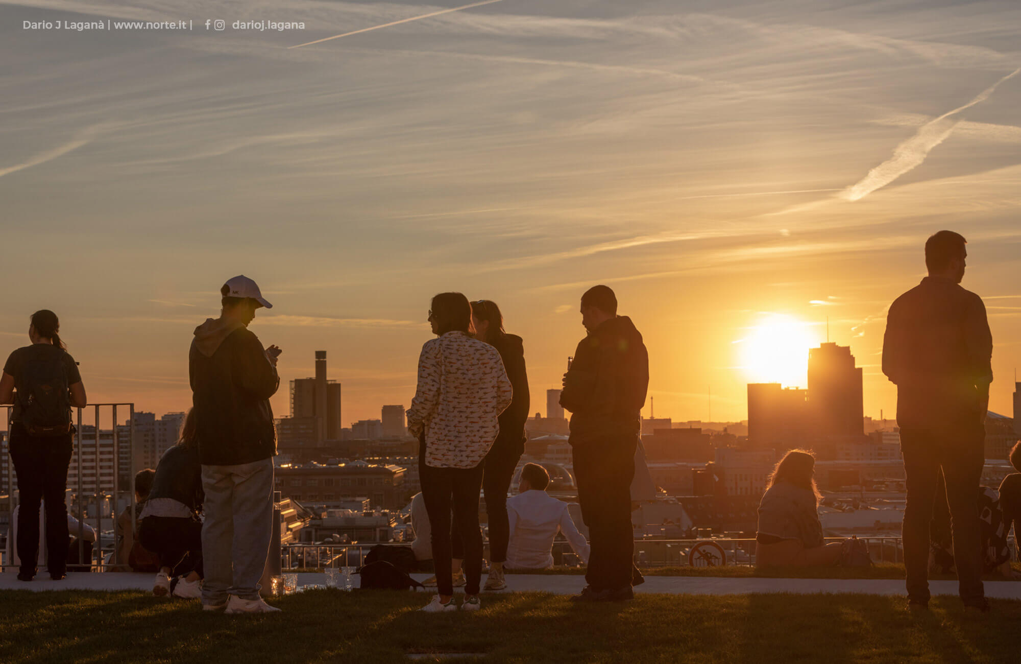 People enjoying the sunset on the REM roof terrace
