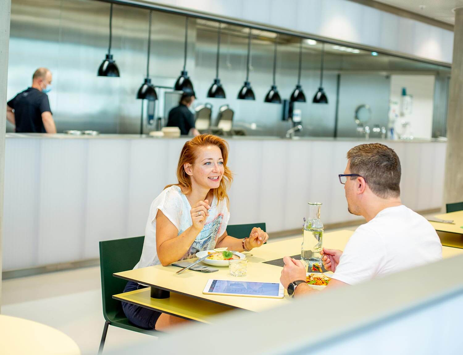 Man and woman sitting at dinner in the DINER